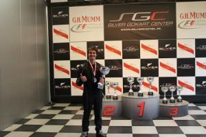 Stefan holding trophy
