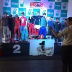 deelnemende Traxxis-piloten op podium bij de Inkart Petronas 12 Hours 2015
